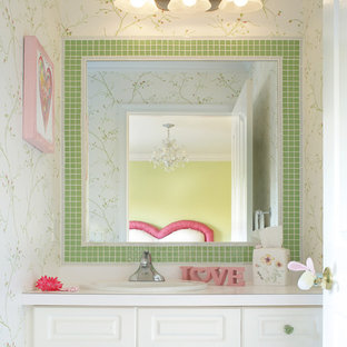 Example of a mid-sized classic kids' white tile and ceramic tile bathroom design in Newark with white cabinets, a drop-in sink, raised-panel cabinets, laminate countertops and white walls