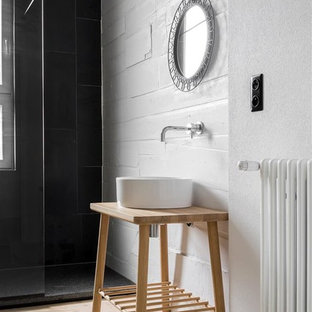 Small mediterranean shower room in Berlin with open cabinets, light wood cabinets, a walk-in shower, a wall mounted toilet, white tiles, stone tiles, white walls, light hardwood flooring, a console sink, wooden worktops, brown floors and an open shower.