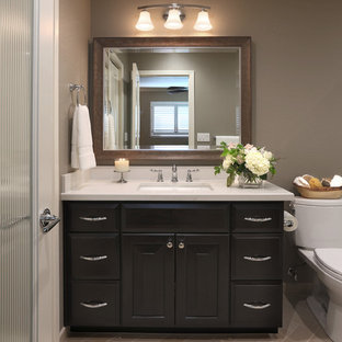 Example of a mid-sized transitional master porcelain tile porcelain floor corner shower design in San Francisco with recessed-panel cabinets, black cabinets, a one-piece toilet, gray walls, an undermount sink and quartzite countertops
