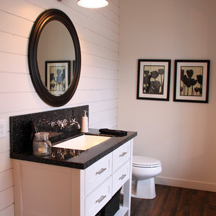 Example of a mid-sized minimalist dark wood floor bathroom design in Minneapolis with an integrated sink, flat-panel cabinets, beige cabinets, marble countertops and beige walls