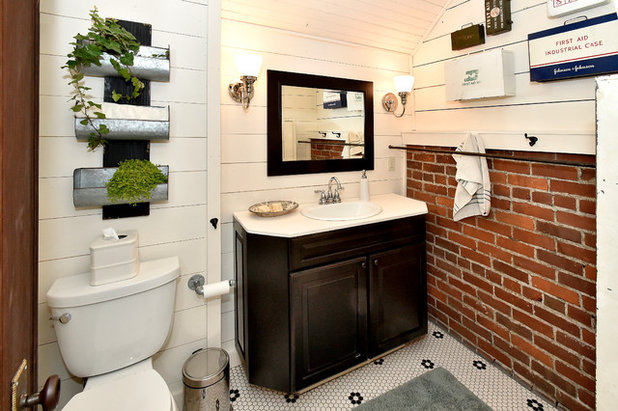 Industrial Bathroom by Architectural Overflow, LLC