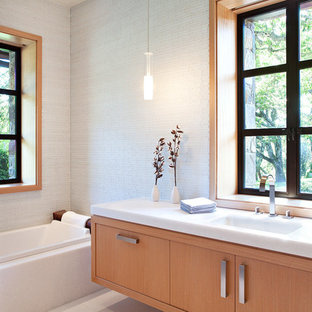 Alcove bathtub - large contemporary master alcove bathtub idea in San Francisco with flat-panel cabinets, light wood cabinets, white walls and an undermount sink
