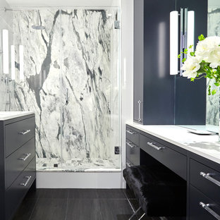 Inspiration for a small contemporary master black tile, gray tile, white tile and stone slab porcelain floor and black floor bathroom remodel in New York with flat-panel cabinets, black cabinets, a one-piece toilet, an undermount sink, solid surface countertops and a hinged shower door