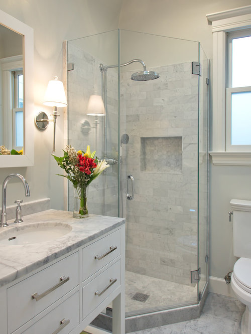 Small transitional gray tile and stone tile marble floor corner shower idea  in San Francisco with