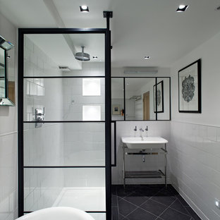 Photo of a contemporary bathroom in London with a console sink and white tile.