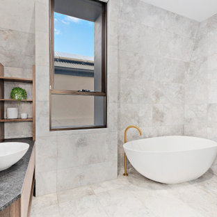 Design ideas for a modern bathroom in Sydney with a freestanding tub, a single vanity and a floating vanity.