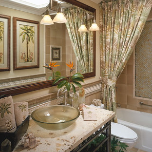 Inspiration for a mid-sized tropical bathroom in San Diego with a vessel sink, open cabinets, an alcove tub, a shower/bathtub combo, brown tile, multi-coloured tile, ceramic tile, beige walls, ceramic floors, terrazzo benchtops, brown floor, a shower curtain and beige benchtops.