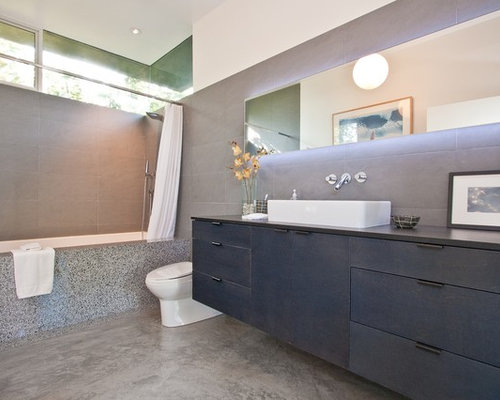 Example Of A Trendy Shower Curtain Design In Los Angeles With A Vessel Sink