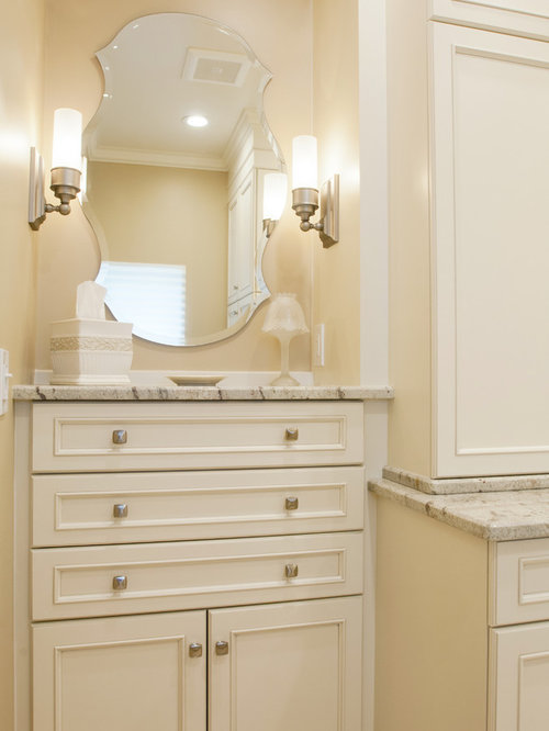 bathroom in orlando with recessed panel cabinets beige cabinets