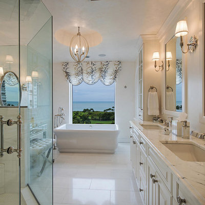 Large elegant bathroom photo in New York with an undermount sink, raised-panel cabinets and white cabinets