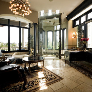Example of a huge tuscan master black tile limestone floor bathroom design in Other with beaded inset cabinets, black cabinets, a one-piece toilet, white walls, an undermount sink and marble countertops