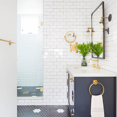 Mid-sized beach style 3/4 white tile and subway tile black floor alcove shower photo in Orange County with shaker cabinets, blue cabinets, an undermount sink, white countertops and a hinged shower door