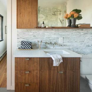 Mid-century modern bathroom photo in Denver