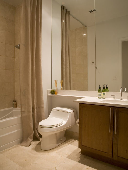 Example Of A Trendy Beige Tile Tub/shower Combo Design In DC Metro With An