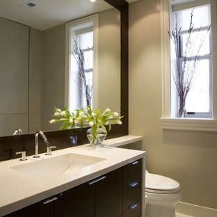 Bathroom - contemporary bathroom idea in DC Metro with an undermount sink, flat-panel cabinets, dark wood cabinets and beige countertops