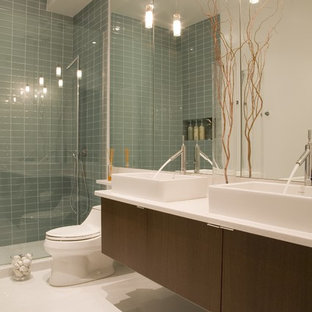 Inspiration for a contemporary glass tile bathroom remodel in DC Metro with a vessel sink and white countertops