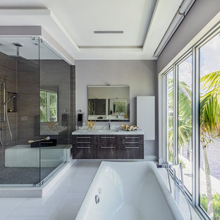 Bathroom - contemporary master brown tile white floor bathroom idea in Miami with flat-panel cabinets, dark wood cabinets, gray walls, an undermount sink, a hinged shower door and gray countertops