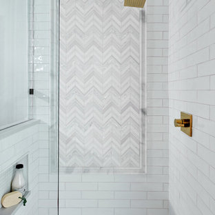 Example of a mid-sized transitional kids' white tile and marble tile porcelain tile and beige floor bathroom design in Austin with flat-panel cabinets, light wood cabinets, a two-piece toilet, white walls, an undermount sink, quartz countertops, a hinged shower door and gray countertops