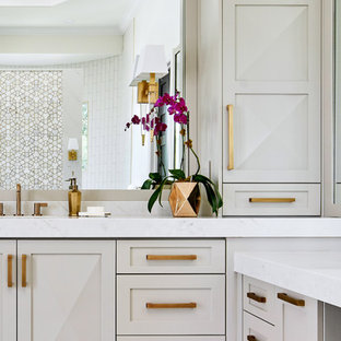 Large transitional master white tile and mosaic tile porcelain tile and white floor bathroom photo in Austin with shaker cabinets, gray cabinets, a one-piece toilet, white walls, an undermount sink, quartz countertops and gray countertops