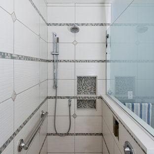 Example of a mid-sized classic beige tile and porcelain tile porcelain floor corner shower design in Other with an undermount sink, flat-panel cabinets, white cabinets, quartz countertops, a two-piece toilet and blue walls