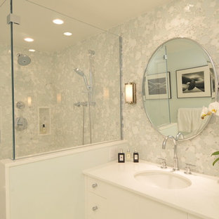 Mid-sized trendy master green tile and glass tile marble floor and white floor alcove shower photo in Boston with an undermount sink, furniture-like cabinets, white cabinets, solid surface countertops, a one-piece toilet, green walls, a hinged shower door and white countertops