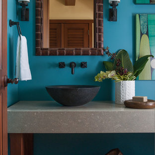 Mid-sized island style bathroom photo in Hawaii with a vessel sink and blue walls