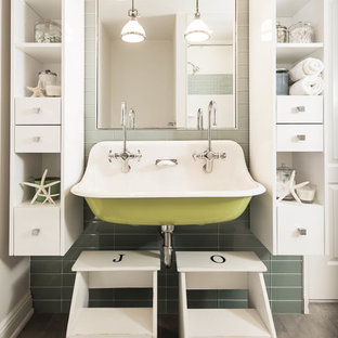 Photo of a nautical family bathroom in New York with white cabinets, green tiles, glass tiles and a trough sink.