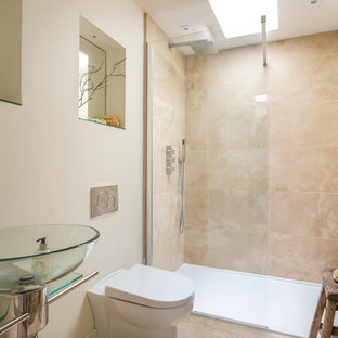 Inspiration for a small country shower room in Gloucestershire with beige tiles, beige walls, beige floors, an alcove shower, a wall mounted toilet, a vessel sink and an open shower.