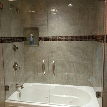 Frameless Double Doors over a Bathtub