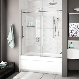 Mid-sized trendy master concrete floor and gray floor bathroom photo in Chicago with flat-panel cabinets, gray walls, an integrated sink and white countertops