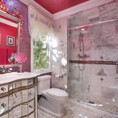Example of an eclectic bathroom design in Orange County with furniture-like cabinets