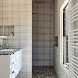 Inspiration for a midcentury bathroom in Melbourne with flat-panel cabinets, white cabinets, a curbless shower, beige tile, mosaic tile, beige walls, mosaic tile floors, an undermount sink, grey floor, an open shower, grey benchtops, a niche, a single vanity and a floating vanity.