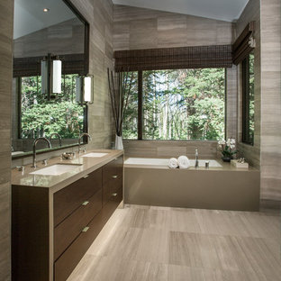 Inspiration for a mid-sized contemporary master gray tile and stone tile limestone floor bathroom remodel in Salt Lake City with an undermount sink, flat-panel cabinets, dark wood cabinets, an undermount tub, quartzite countertops and gray walls