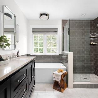 Example of a large transitional master subway tile and gray tile marble floor and beige floor bathroom design in Other with shaker cabinets, black cabinets, white walls, quartz countertops, a hinged shower door, beige countertops and an undermount sink