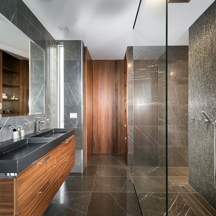 This is an example of a contemporary bathroom in Perth with flat-panel cabinets, dark wood cabinets, gray tile, an integrated sink and an open shower.