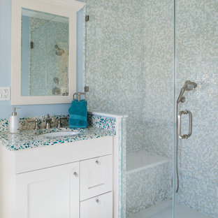 Photo of a mid-sized traditional 3/4 bathroom in New York with an undermount sink, shaker cabinets, white cabinets, an alcove shower, multi-coloured tile, mosaic tile, blue walls, blue benchtops, recycled glass benchtops, white floor and a hinged shower door.