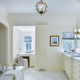Example of a mid-sized french country master white tile and marble tile marble floor, white floor and double-sink drop-in bathtub design in Minneapolis with recessed-panel cabinets, white cabinets, white walls, an integrated sink, marble countertops, white countertops and a built-in vanity