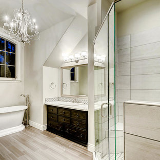 Example of a mid-sized french country 3/4 porcelain tile and beige floor bathroom design in Denver with furniture-like cabinets, dark wood cabinets, white walls, a drop-in sink, marble countertops, a hinged shower door and white countertops