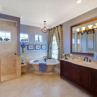 """""""french country bathroom"""". Example of a tuscan freestanding bathtub design in Orlando with raised-panel cabinets"""