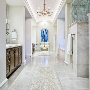 Expansive mediterranean ensuite bathroom in Austin with recessed-panel cabinets, medium wood cabinets and an alcove bath.