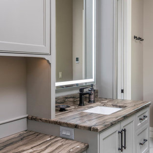 Inspiration for a large transitional master white tile and marble tile marble floor and white floor corner shower remodel in Other with recessed-panel cabinets, beige cabinets, an undermount tub, beige walls, an undermount sink, quartzite countertops, a hinged shower door and beige countertops