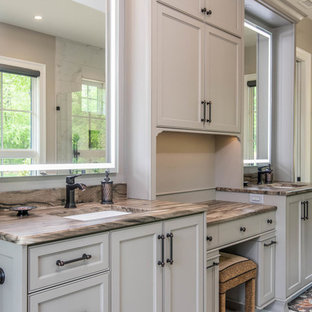 Example of a large transitional master white tile and marble tile marble floor and white floor corner shower design in Other with recessed-panel cabinets, beige cabinets, an undermount tub, beige walls, an undermount sink, quartzite countertops, a hinged shower door and beige countertops