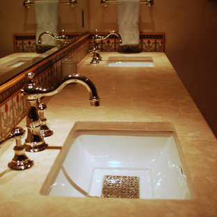Medium sized family bathroom in Albuquerque with recessed-panel cabinets, green cabinets, a built-in bath, multi-coloured tiles, ceramic tiles, beige walls, terracotta flooring, a submerged sink and marble worktops.