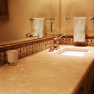 Photo of a medium sized family bathroom in Albuquerque with recessed-panel cabinets, green cabinets, a built-in bath, multi-coloured tiles, ceramic tiles, beige walls, terracotta flooring, a submerged sink and marble worktops.