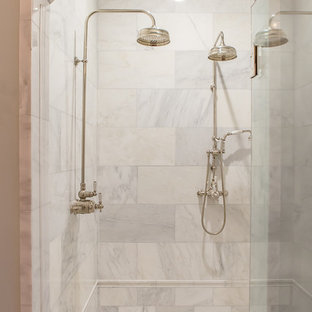 This is an example of a large mediterranean ensuite bathroom in Houston with freestanding cabinets, beige cabinets, a freestanding bath, a double shower, a two-piece toilet, beige tiles, stone slabs, beige walls, terracotta flooring, a submerged sink and marble worktops.