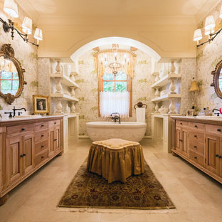 Inspiration for a mediterranean bathroom in Houston with medium wood cabinets and a freestanding bath.