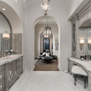 Bathroom - huge master multicolored tile and mirror tile porcelain floor and multicolored floor bathroom idea in Phoenix with furniture-like cabinets, gray cabinets, a one-piece toilet, white walls, a drop-in sink, quartzite countertops, a hinged shower door and multicolored countertops