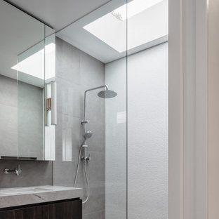 Photo of a large contemporary bathroom in Sydney with an undermount sink, granite benchtops, an open shower, a double vanity, dark wood cabinets, flat-panel cabinets, an alcove shower, gray tile, grey floor, grey benchtops and a floating vanity.