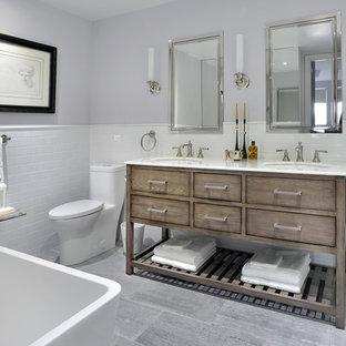 Idéer för ett litet klassiskt vit badrum med dusch, med möbel-liknande, skåp i mellenmörkt trä, ett fristående badkar, en toalettstol med hel cisternkåpa, vit kakel, keramikplattor, grå väggar, marmorgolv, ett undermonterad handfat och bänkskiva i kvartsit