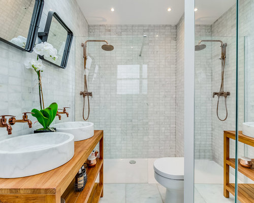 this is an example of a small classic bathroom in london with open cabinets a